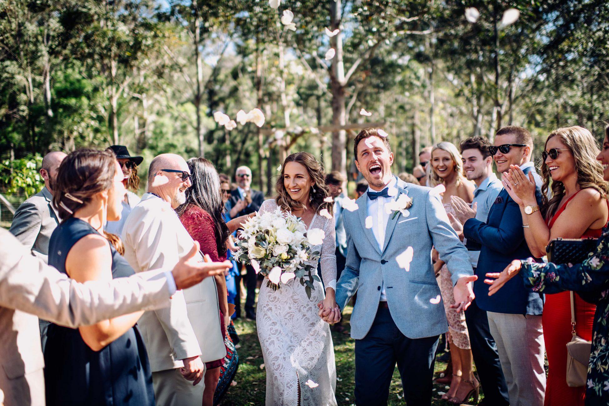 Outdoor Wedding Ceremony with bush backdrop